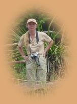 Typical safari wear - female style : 'zippy' trousers ; light weight shirt ; baseball cap ; comfortable footwear