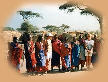Maasai village - the two girls have been adopted by the tribeswomen.